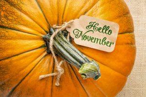 47777329 - hello november price tag on a pumpkin against burlap canvas